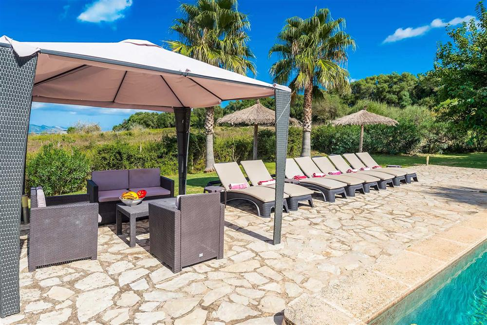 Seating area, sunloungers at Villa Les Roques de can Guixe, Pollensa, Mallorca