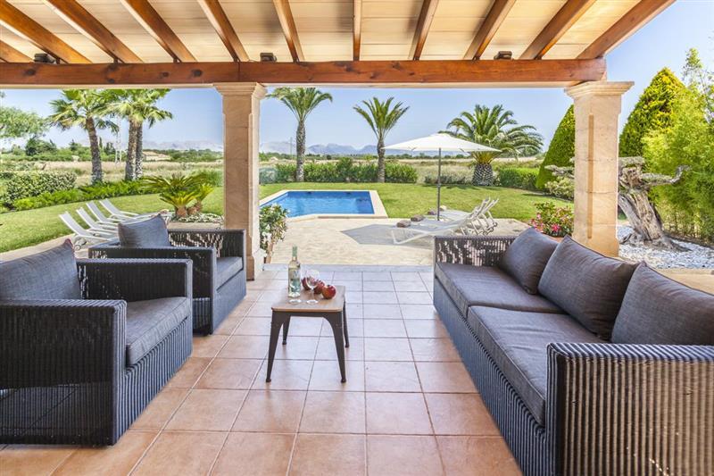 Outside seating at Villa Lirio, Alcudia, Spain