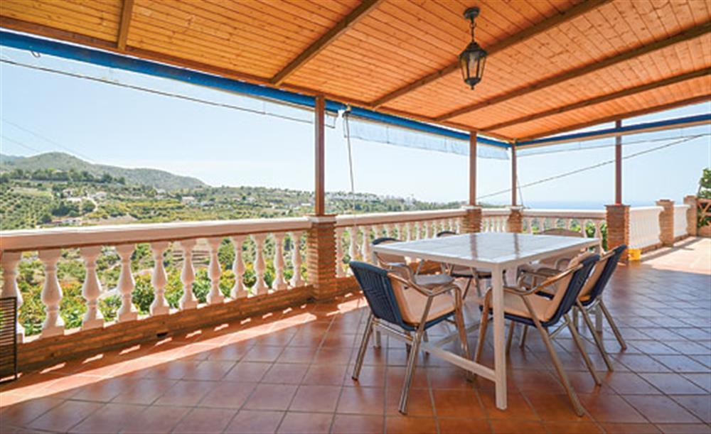 Outdoor shaded dining at Villa Paloma, Frigiliana, Andalucia