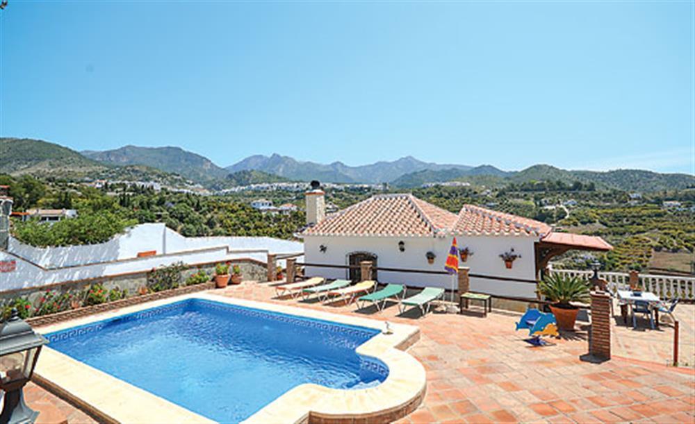 Swimming pool and garden at Villa Paloma, Frigiliana, Andalucia