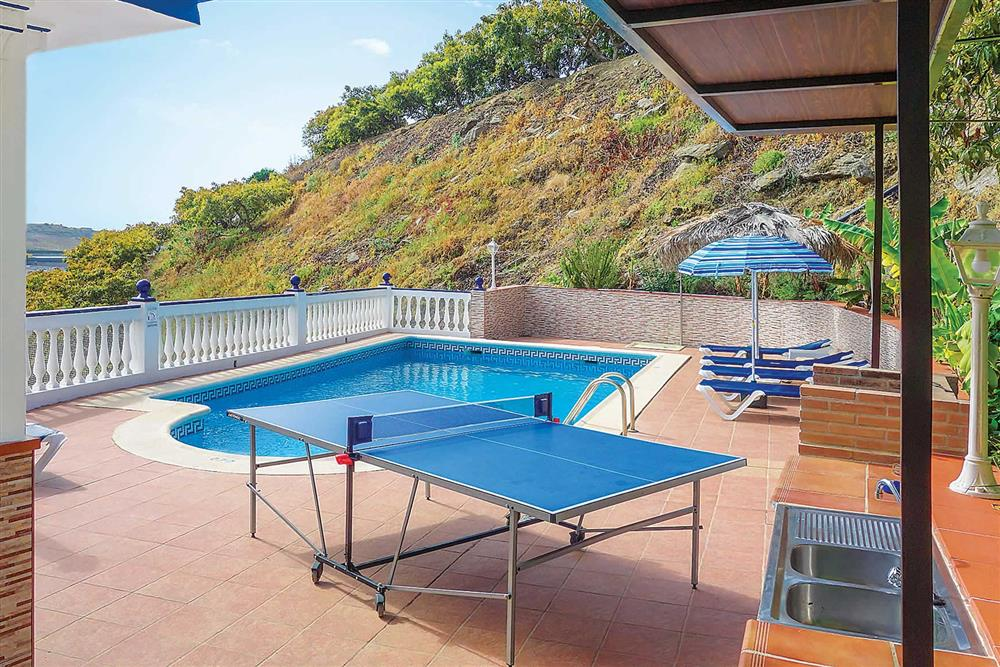 Swimming pool and paved garden at Villa Sanchez Y Rico, Nerja Andalucia, Spain