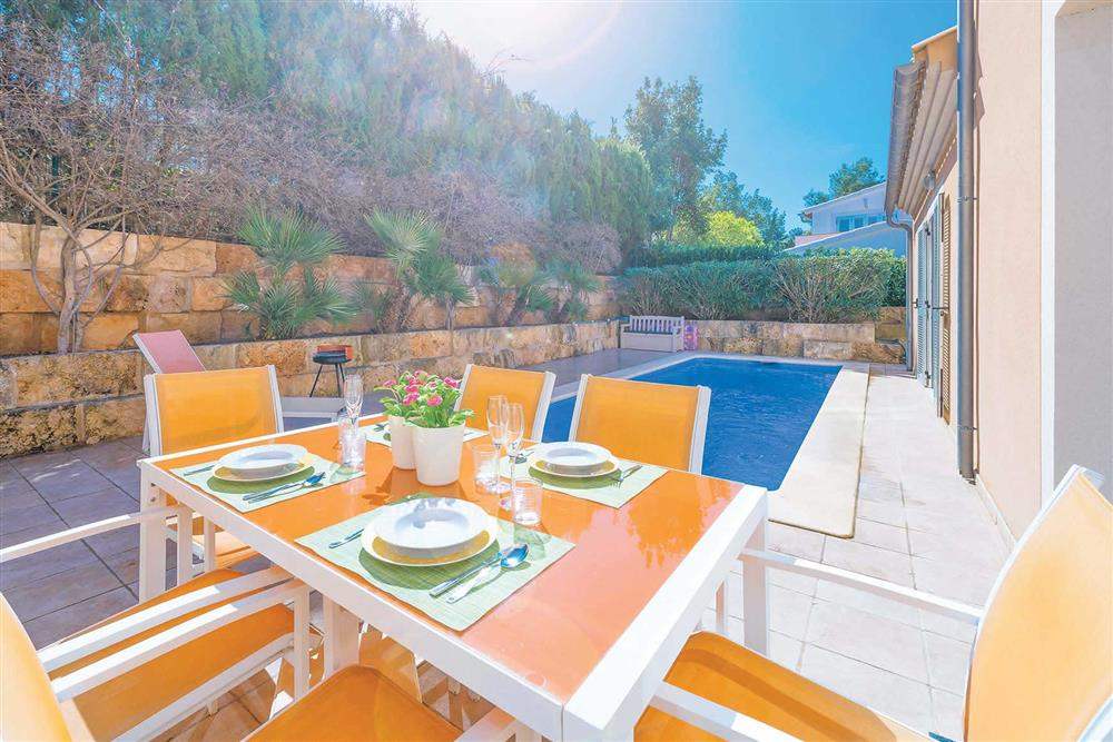 Alfresco dining, pool at Villa Synera, Alcudia, Mallorca