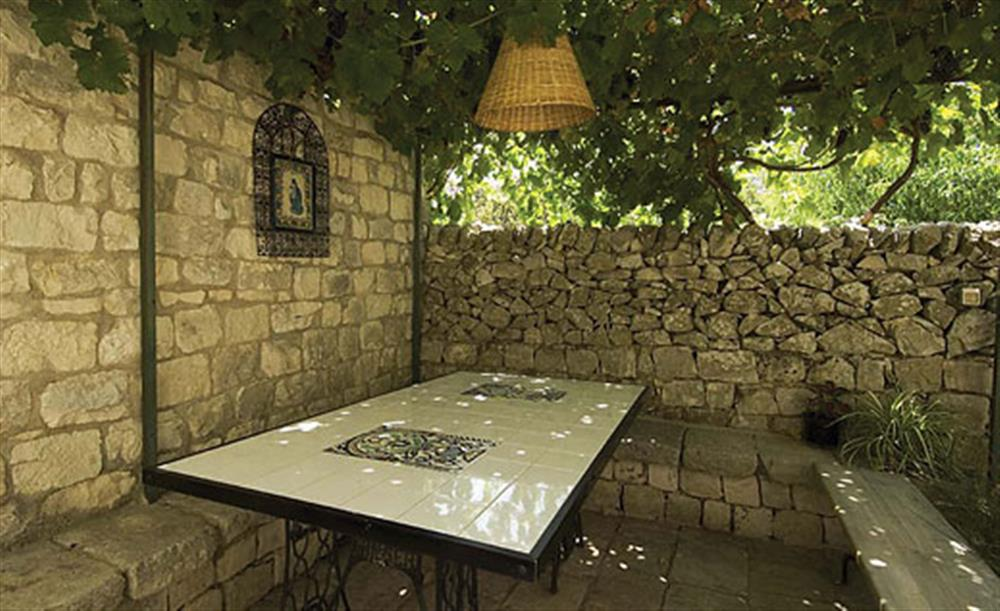 Outdoor seating in the shade at Villa Trombadore, Modica Sicily, Italy