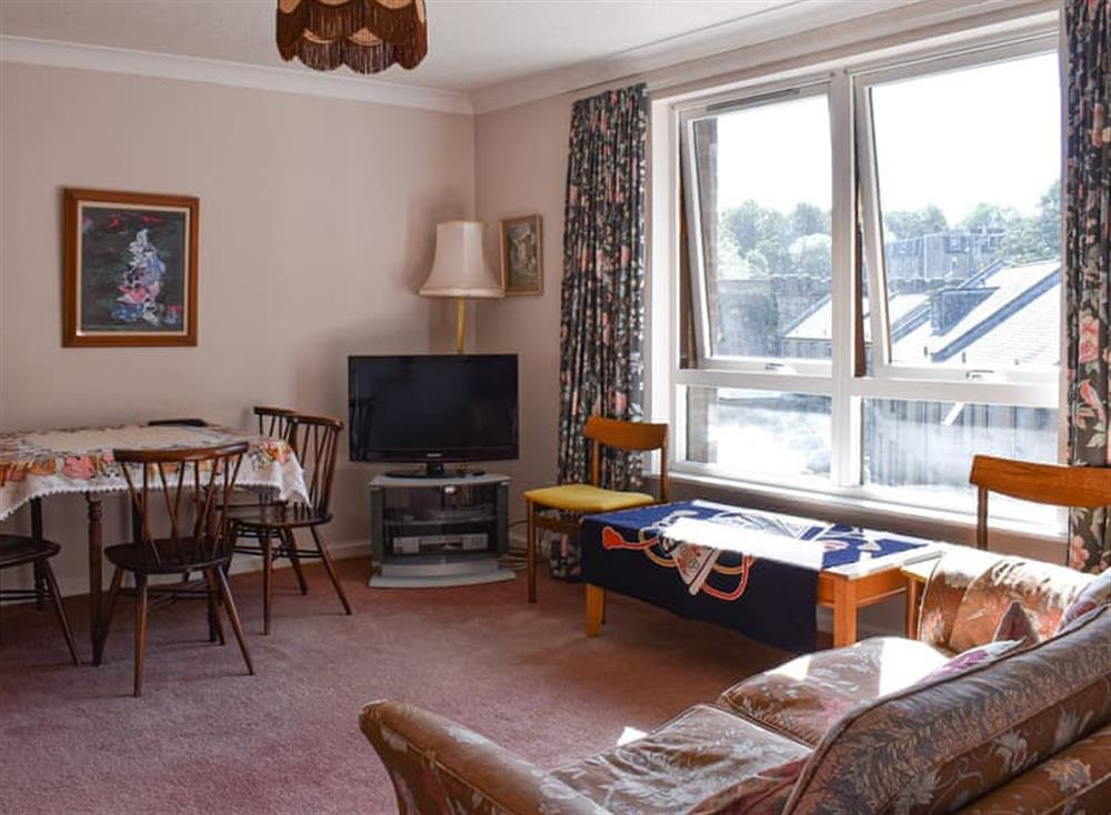 Living room with dining area at Village Apartment in Edinburgh, Midlothian