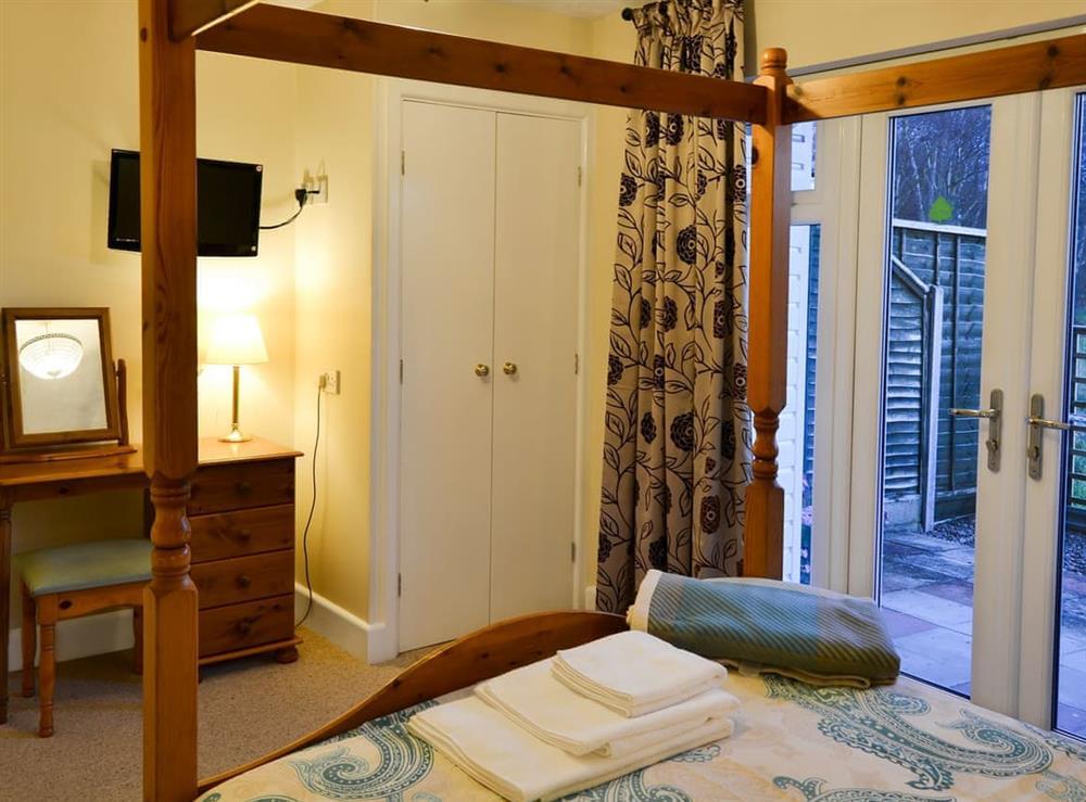 Four Poster bedroom (photo 2) at Wanderer in Sutton Staithe, near Stalham, Norfolk