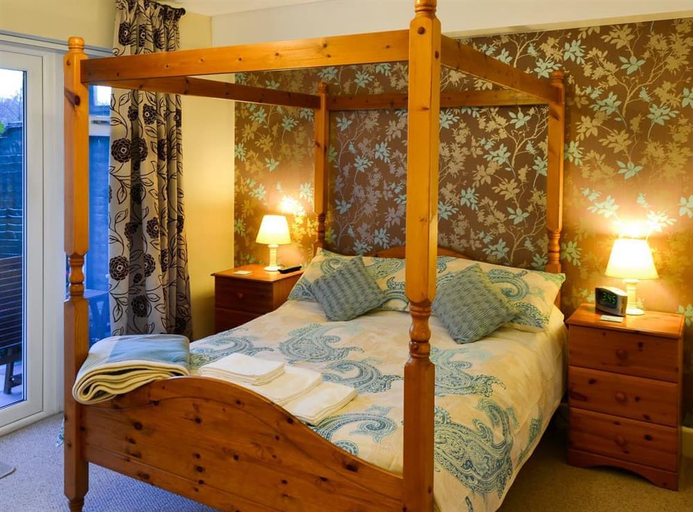 Four Poster bedroom at Wanderer in Sutton Staithe, near Stalham, Norfolk