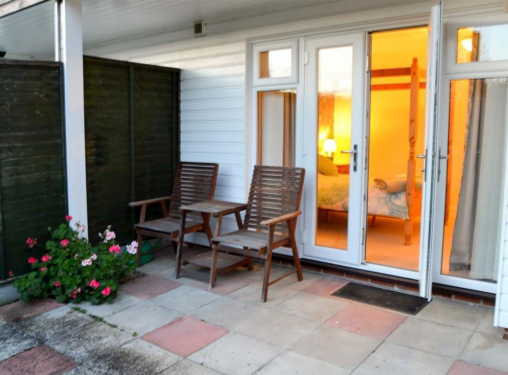 Small enclosed garden with sitting-out area and garden furniture at Wanderer in Sutton Staithe, near Stalham, Norfolk