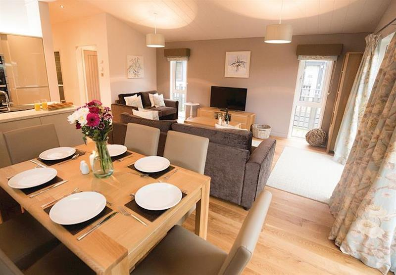 The dining and living area at Wareham Forest Lodge Retreat in Holton Heath, Dorset