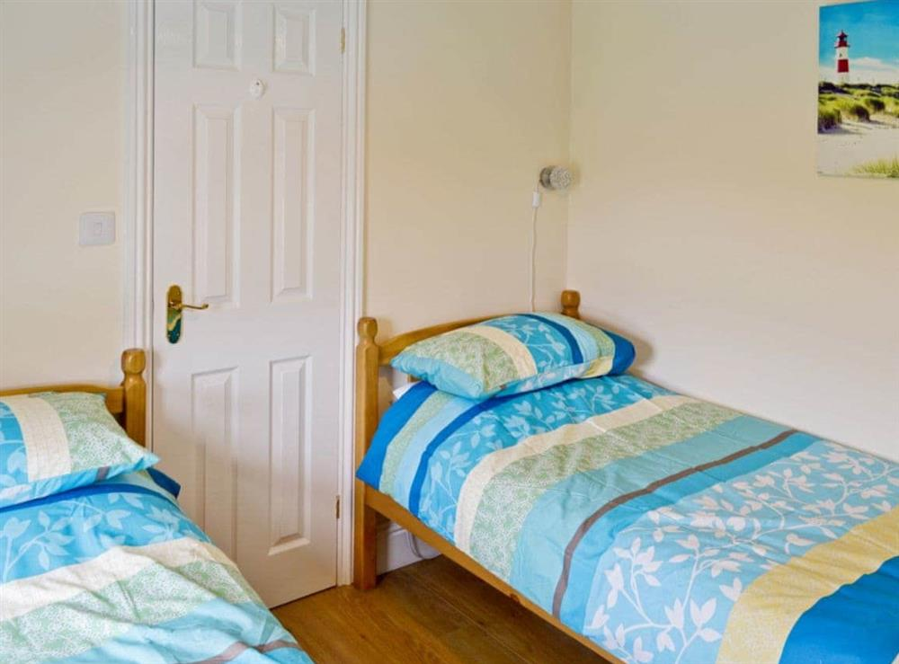 Twin bedroom at Watchkeepers Cottage in Mundesley, Norfolk