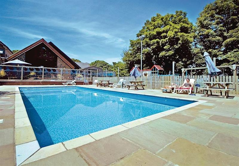 Outdoor heated swimming pool at Watermouth Lodges in North Devon, South West of England