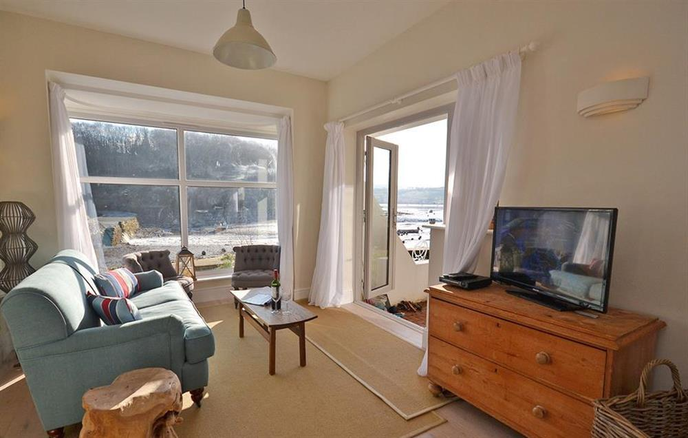 Another view of the sitting room with French windows to a small terrace at Waters Edge, Stoke Gabriel