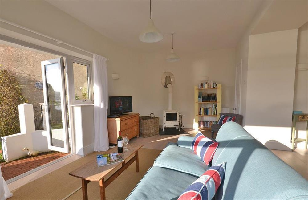 The living area benefits from a wood burning stove at Waters Edge, Stoke Gabriel