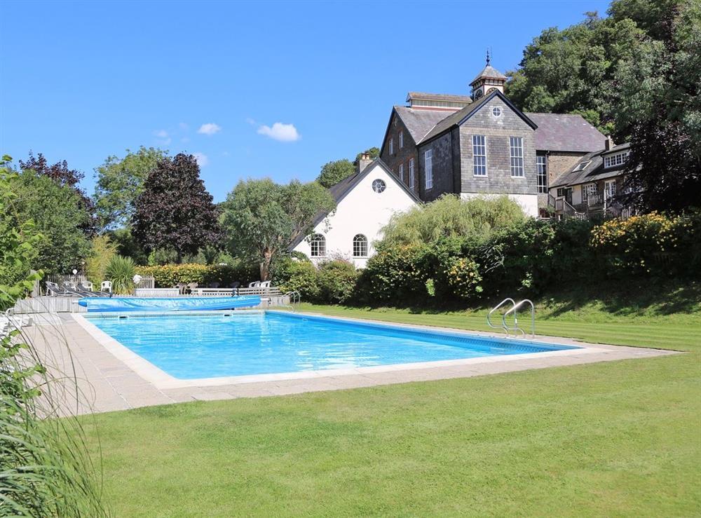 Outdoor pool at Waterwheel in Bow Creek, Nr Totnes, South Devon., Great Britain