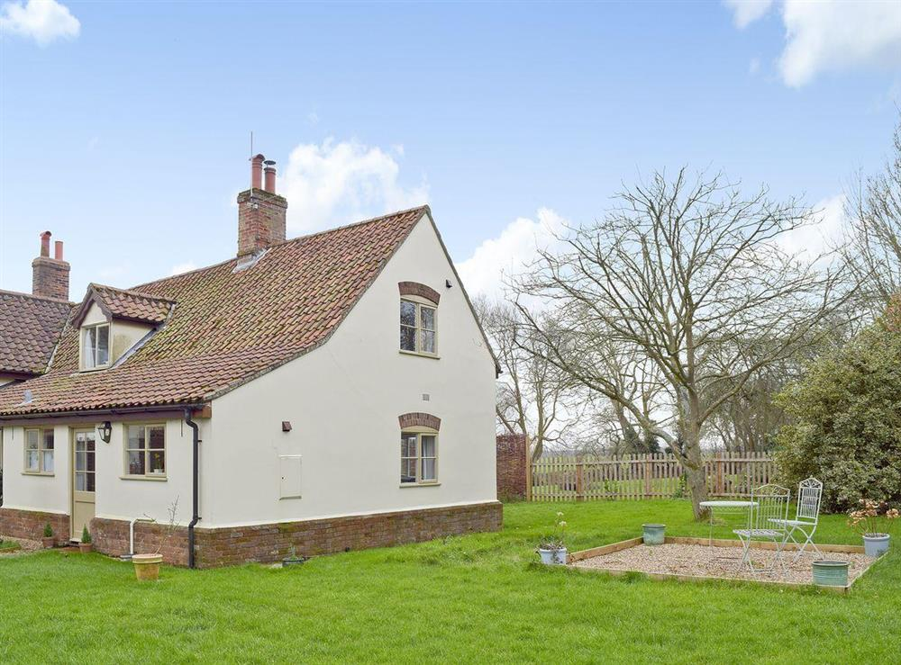 Exterior with large garden & seating area at Waveney Lodge Cottage in Toft Monks, near Beccles, Norfolk