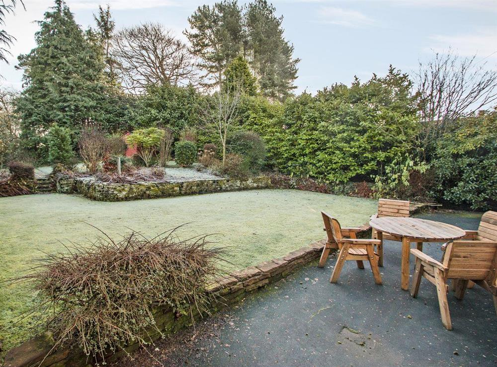 Large enclosed lawned garden with sitting-out area at Wellpark in Alloway, near Ayr, Ayrshire