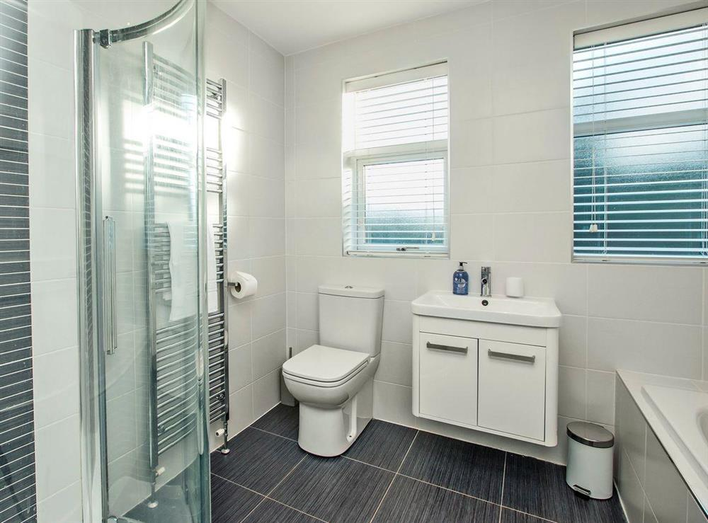 Modern bathroom with bath and shower cubicle at Wellpark in Alloway, near Ayr, Ayrshire