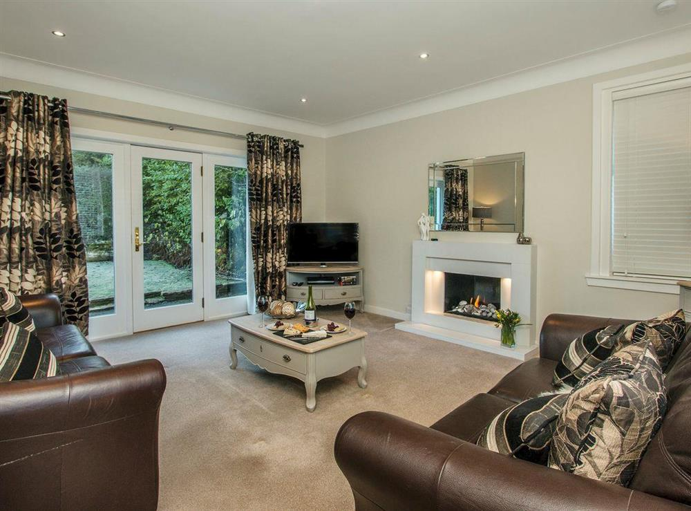 Welcoming living room with French doors to garden at Wellpark in Alloway, near Ayr, Ayrshire
