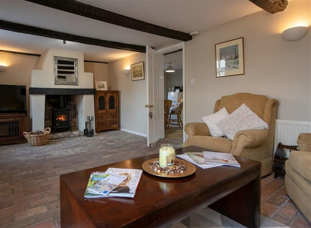 Living room with brick floor & exposed beams at West View in Dickleburgh, near Diss, Norfolk