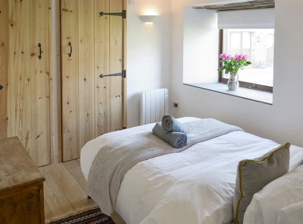 Comfortable ground floor double bedroom with en-suite at Mad Nelly Cottage,