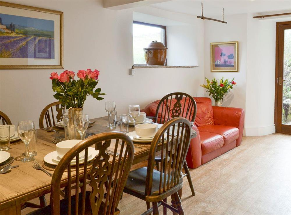 Dining room with additional comfy seating area at Mad Nelly Cottage,