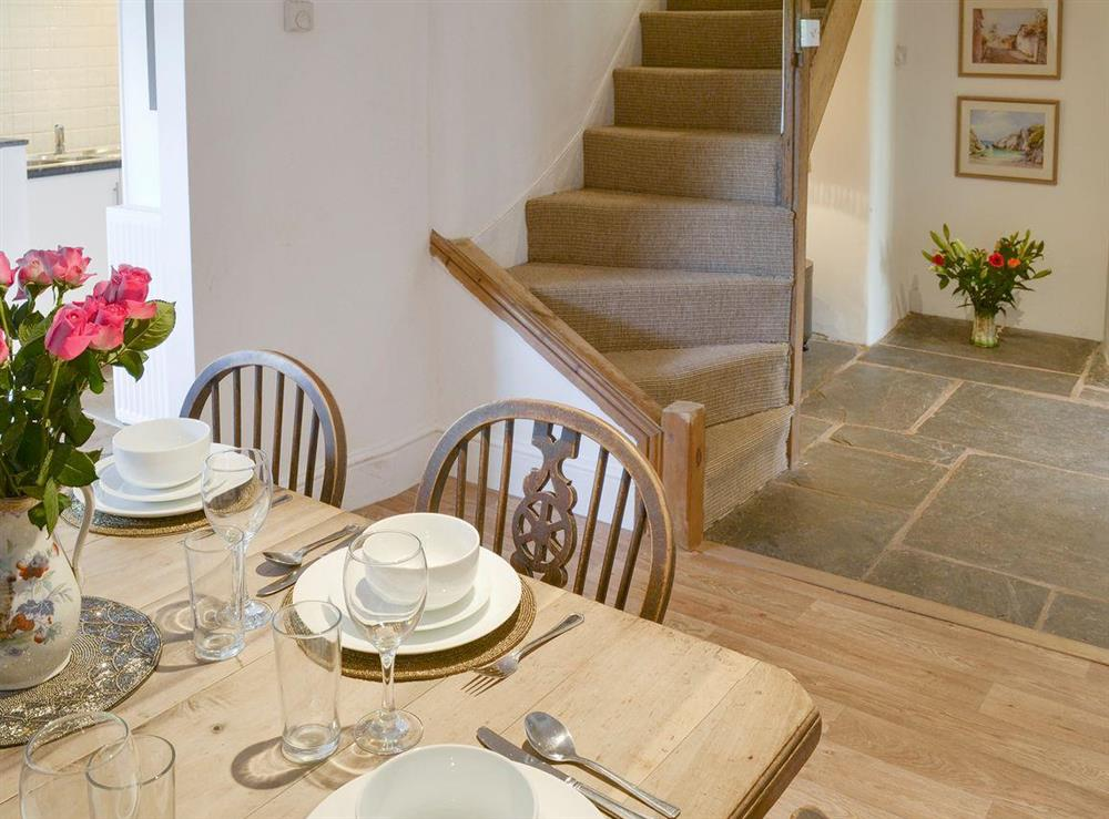 Dining room with open aspect to hallway at Mad Nelly Cottage,