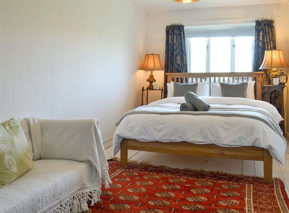 Peaceful first floor double bedroom at Mad Nelly Cottage,