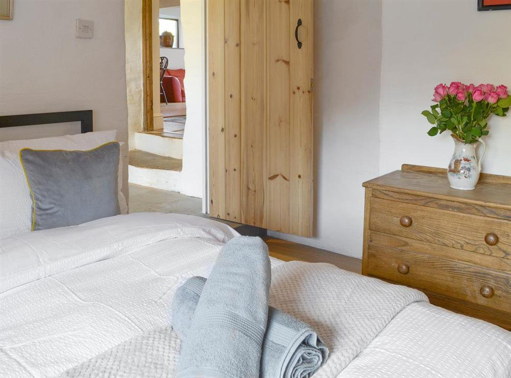 Relaxing ground floor double bedroom at Mad Nelly Cottage,