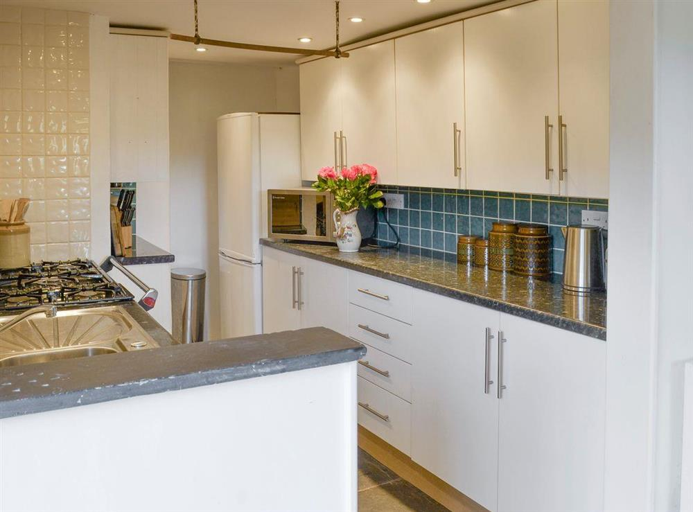 Well-equipped fitted kitchen at Mad Nelly Cottage,