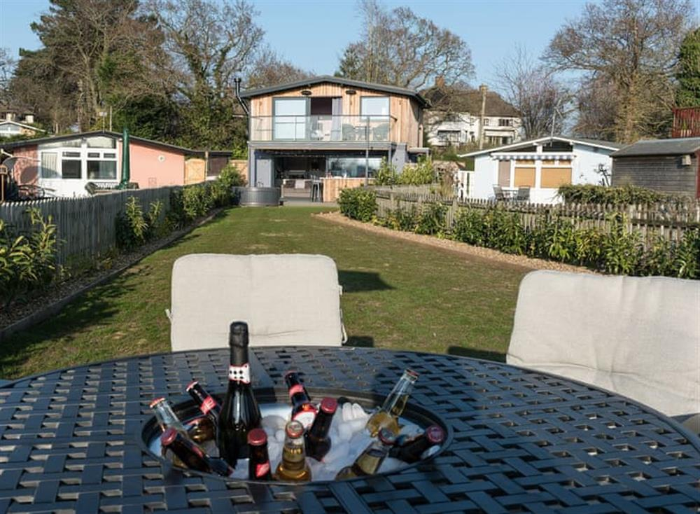 Garden with seating area at Whispering Reeds in Horning, near Wroxham, Norfolk