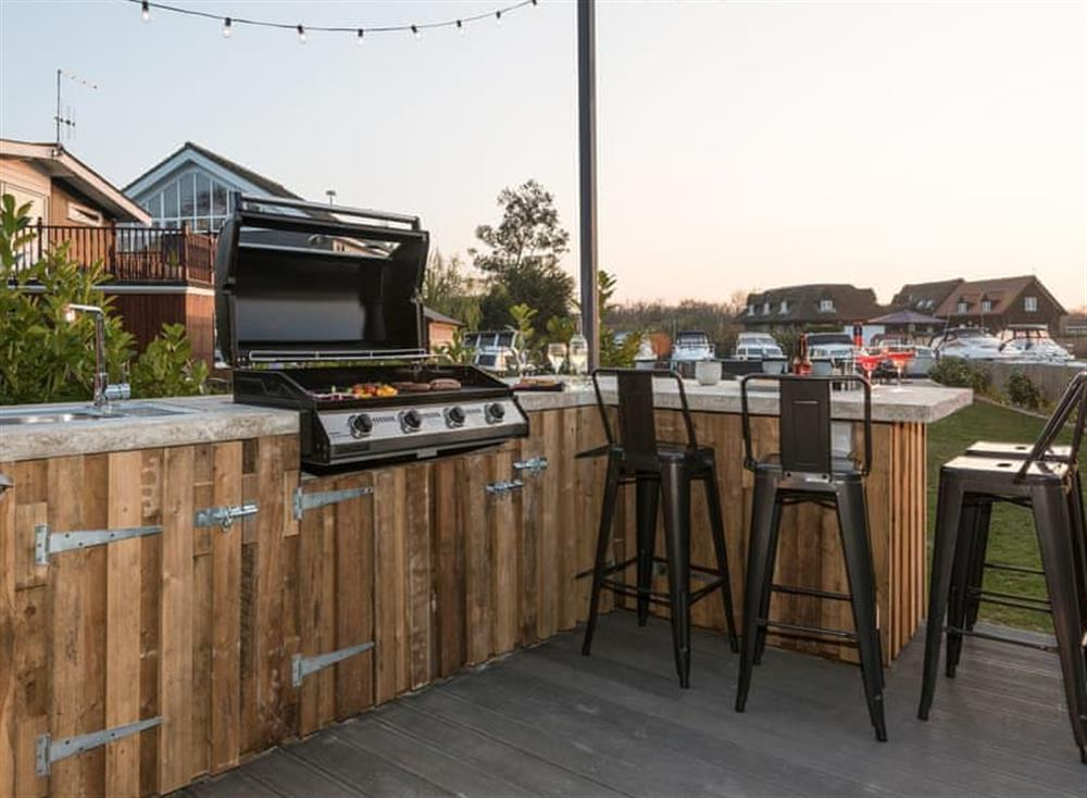 Outdoor area with BBQ at Whispering Reeds in Horning, near Wroxham, Norfolk