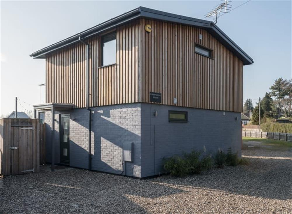 Rear exterior with parking at Whispering Reeds in Horning, near Wroxham, Norfolk