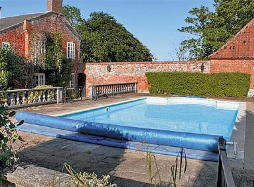 Swimming pool at White House Farm in Fring, near Kings Lynn, Norfolk