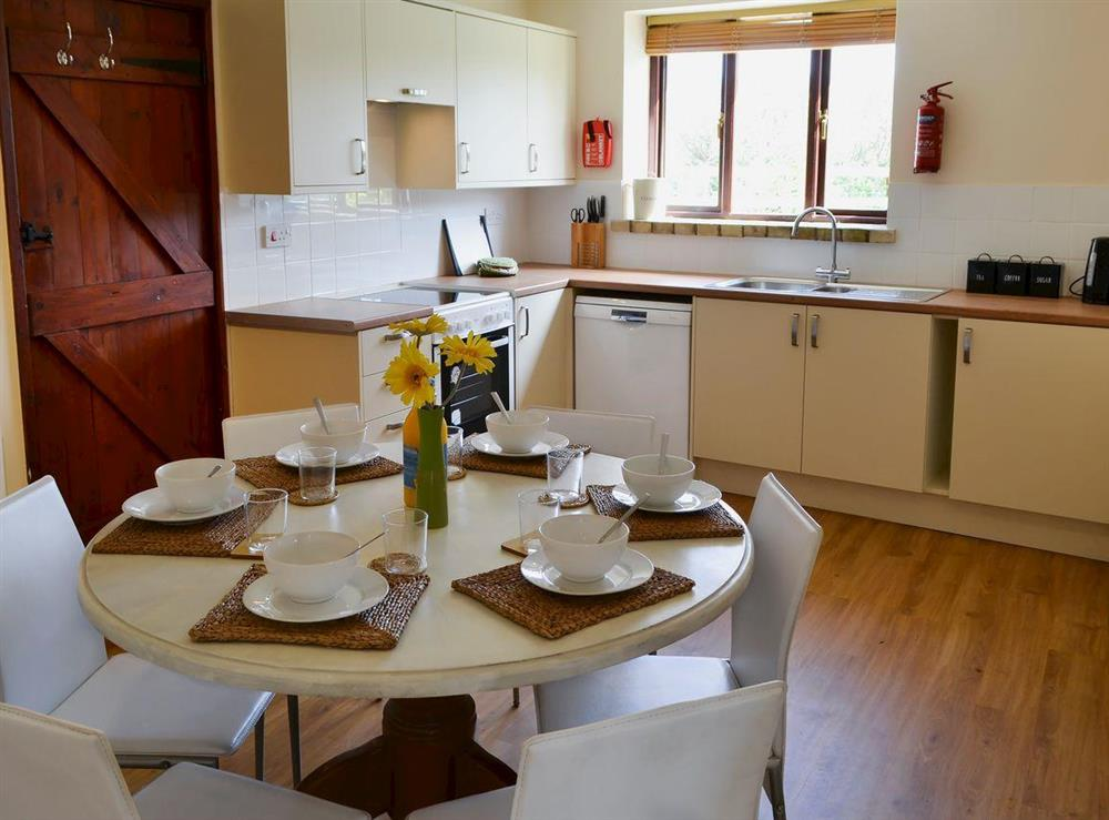 Kitchen and dining area at Flint Barn,