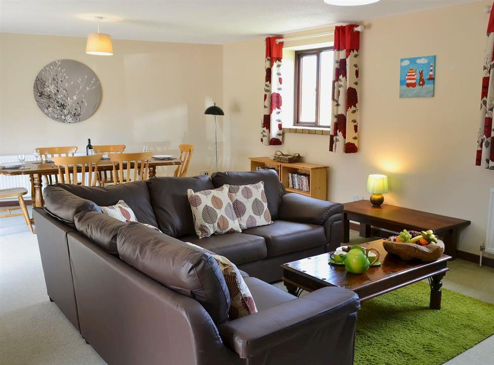 Spacious living and dining area at Flint Barn,