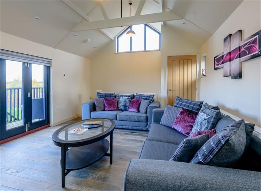 Relaxing living room with fantastic rural views at Yoxford Barn,