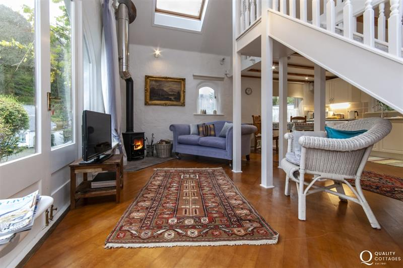 Living room with t.v wifi and log burning stove at Wisteria Lodge, Pembrokeshire