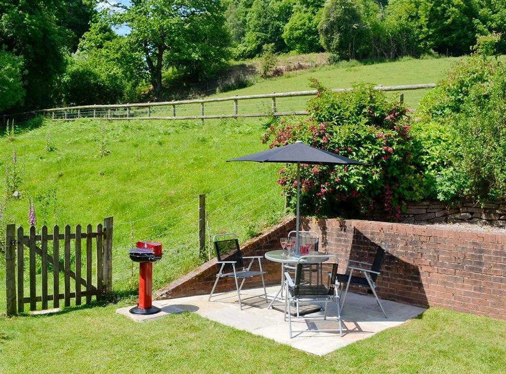 Chamring garden, patio area at Wonder Box Cottage in Popes Hill, nr Newnham-on-Severn, Gloucestershire