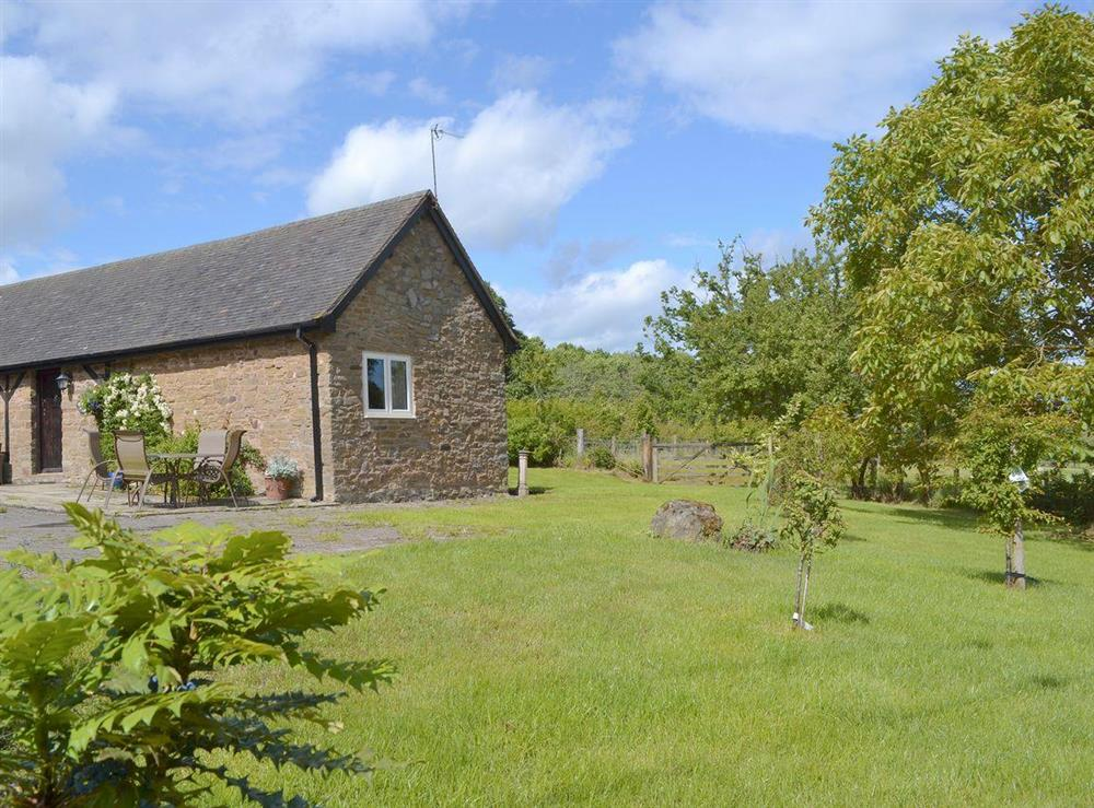 Located within well-tended gardens and grounds at The Old Barn,