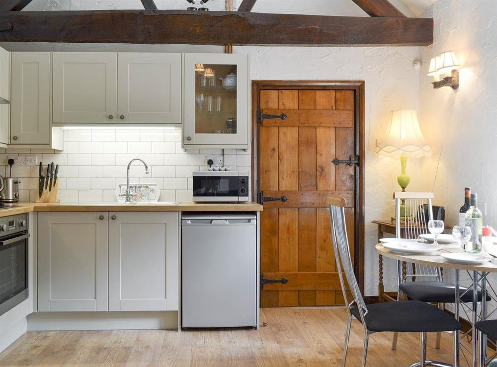 Well-equipped kitchen within the open-plan living space at The Old Barn,