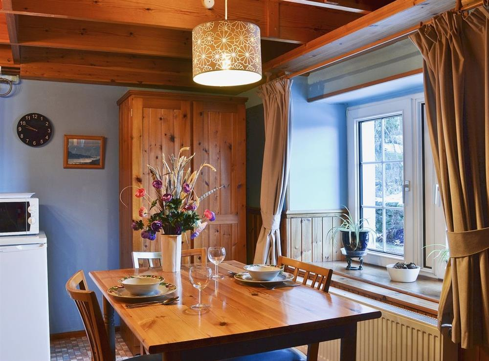 Dining Area at Woodpecker Cottage in North Kessock, Inverness, Inverness-Shire