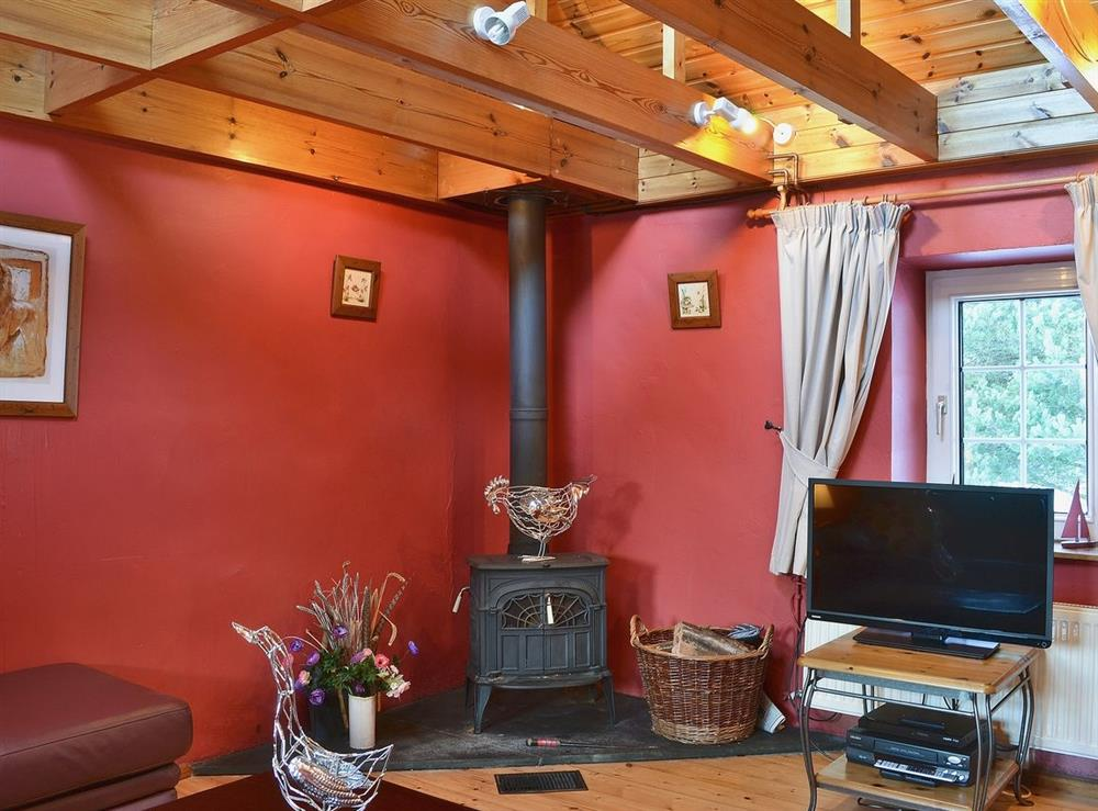 Living room at Woodpecker Cottage in North Kessock, Inverness, Inverness-Shire