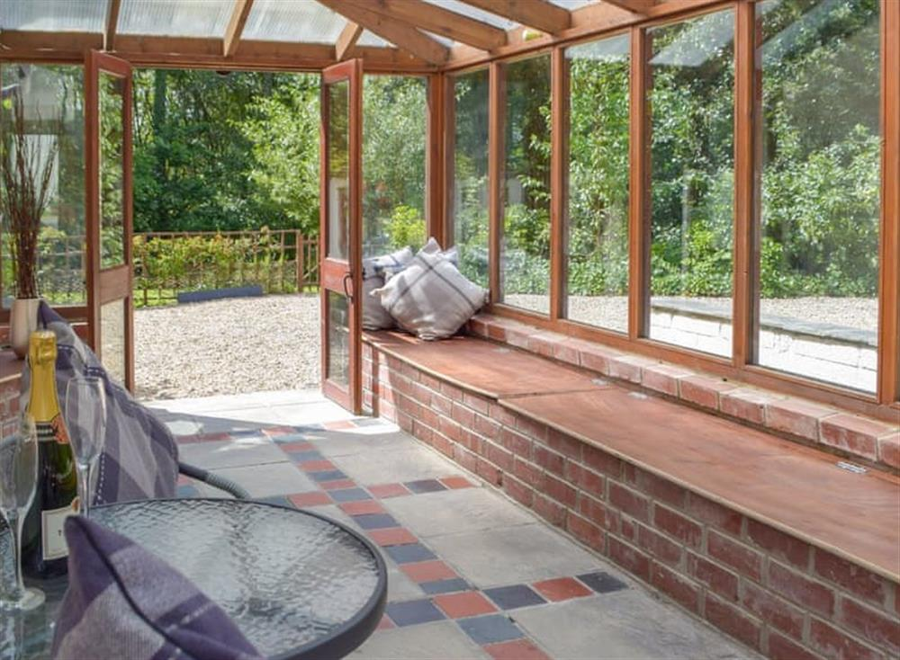 Light and airy sun room at Woodpecker Rest in Llechryd, near Cardigan, Cardigan, Dyfed