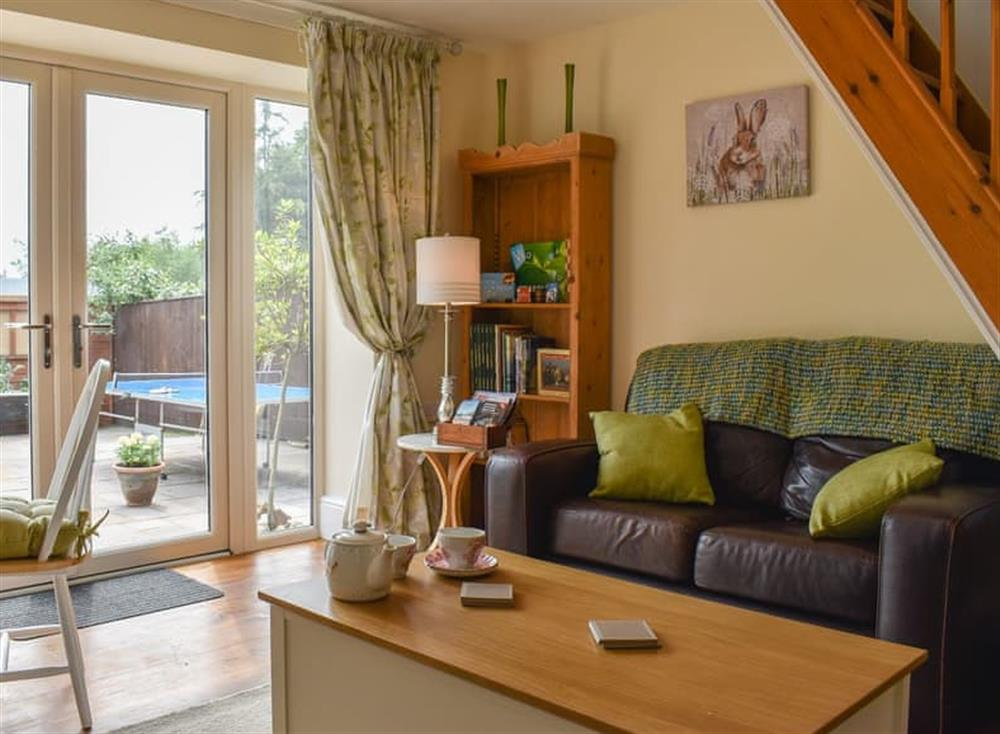 Living room/dining room with French doors to the patio at Woodside Cottage in Near Easington, Cleveland