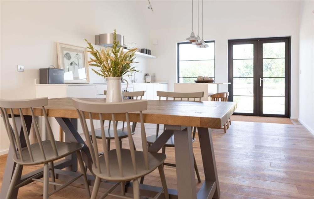 Ground floor: Dining table seating four guests