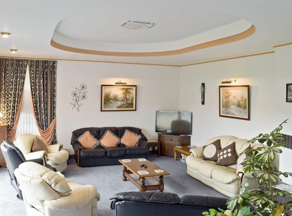 Elegant sunken lounge at Y Dorlan in Cardigan, Dyfed