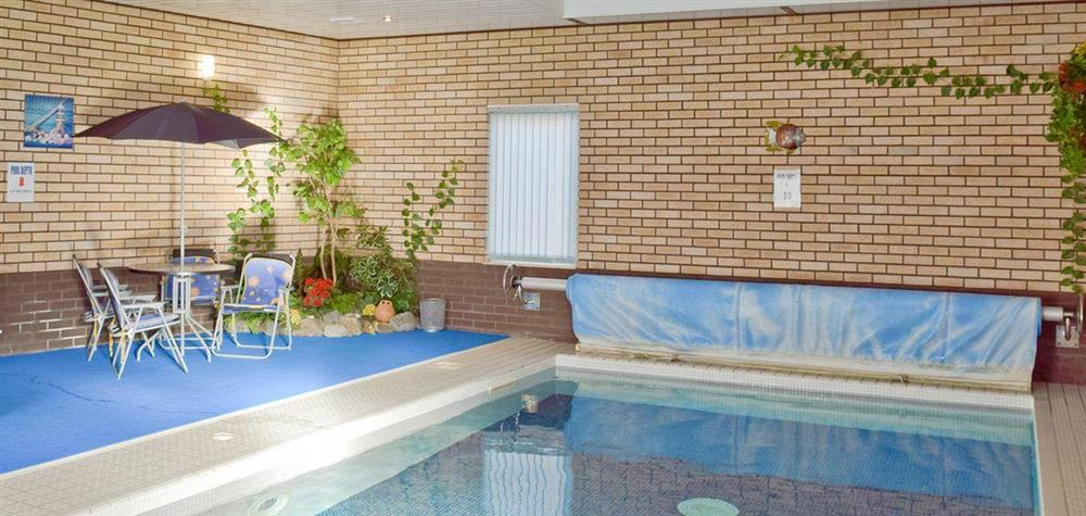 Luxurious heated indoor swimming pool at Y Dorlan in Cardigan, Dyfed