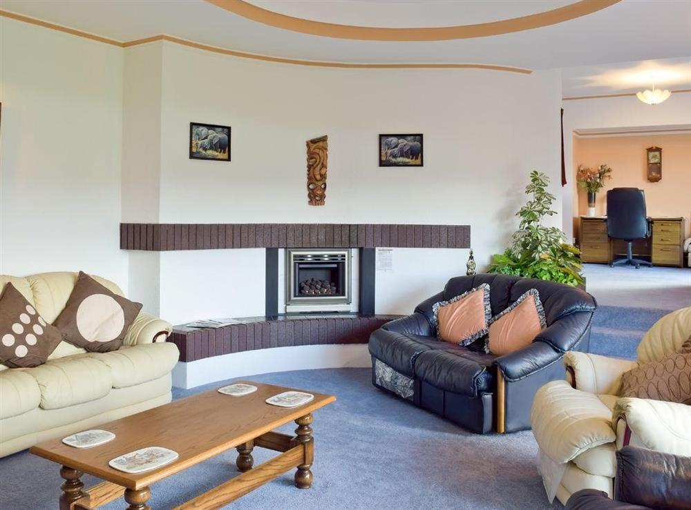 Stylish lounge leads up to study area at Y Dorlan in Cardigan, Dyfed